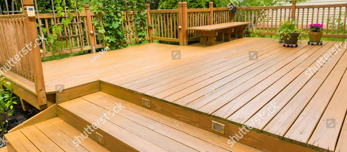 stock-photo-wooden-deck-of-family-home-672201631